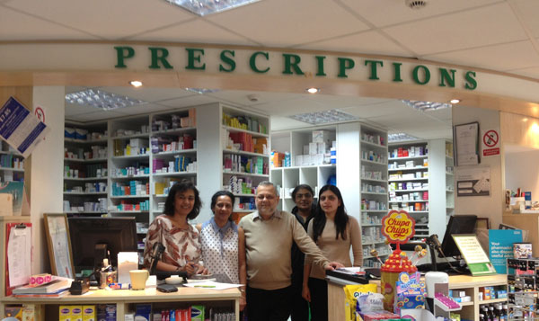 Pharmacy team behind the counter