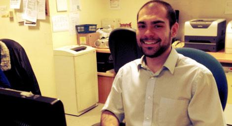 Member of staff smiling